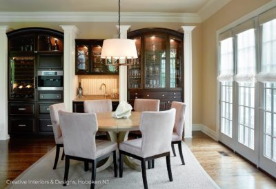 Traditional dark wood china cabinet in this transitional modern dining room interior design.