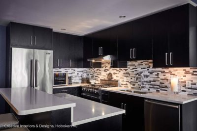 Black white and grey mosaic tile backsplash in this black and white kitchen remodel.