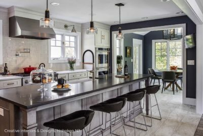 Unique grey subway tile basket weave backsplash in this modern kitchen remodel.