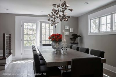 Branching globe chandelier over modern farmhouse style dining table.