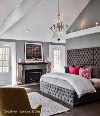 Large elegant dark grey tufted headboard in this luxurious grand bedroom.