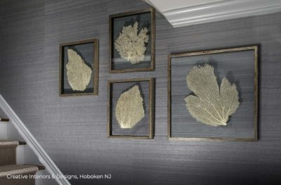 Framed sea fan wall decor and textured modern grey wallpaper is stairway wall art.