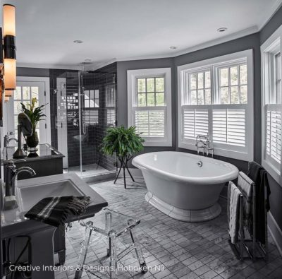 Elegant and Iconic bathroom design with free standing tub and pedestal sink.