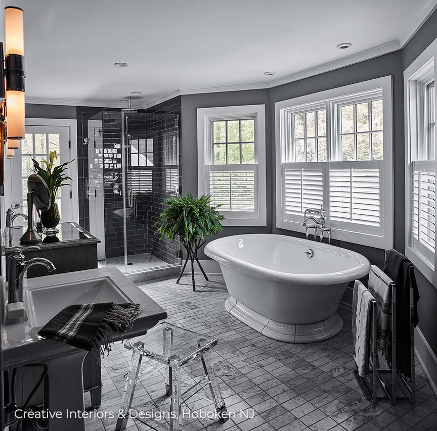Luxurious grey bathroom with free standing tub.