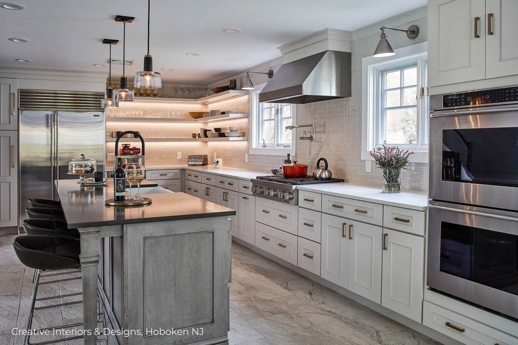 A   kitchen remodel features white cabinets.