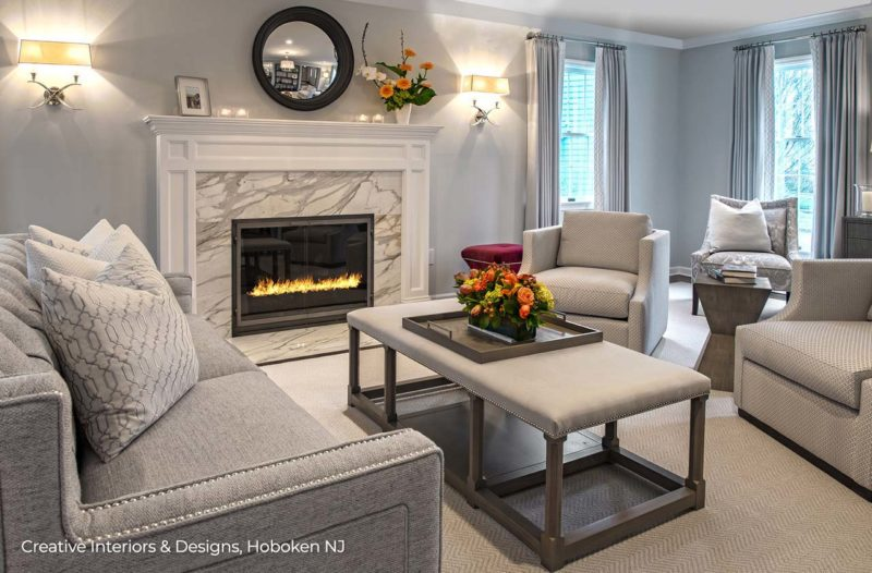 Modern Transitional living room with neutral gray palette, fireplace with marble surround.