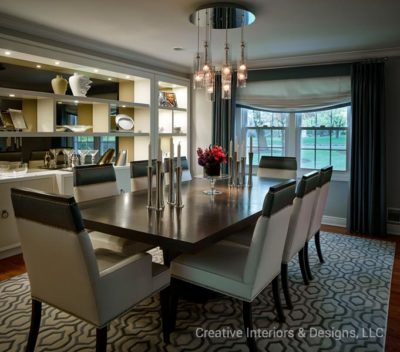 Modern elegant dining room has custom built in wall unit.