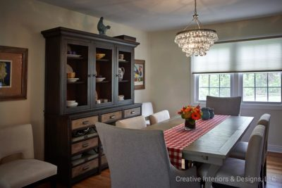 Modern farmhouse china cabinet and grey farmhouse dining table.