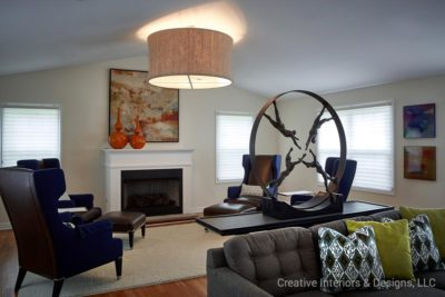 Black leather wing back chairs in this modern living room design in berkeley heights nj.