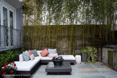 Modern sectional sofa in luxury apartment patio.