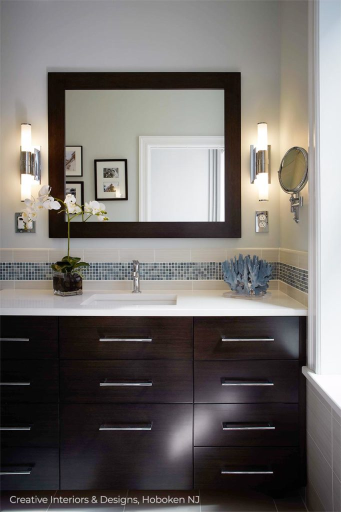 Modern white bathroom remodel with black vanity.
