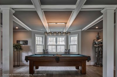 Pool table with Medieval knight armor statue in this family game room.