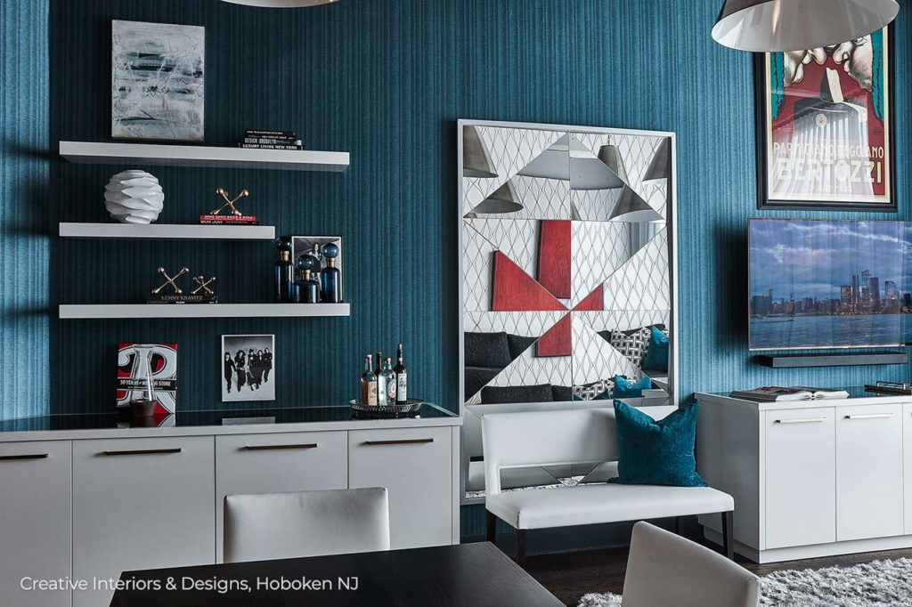 This urban contemporary apartment interior design features a unique architectural wall mirror offset by bold blue textured wallpaper.