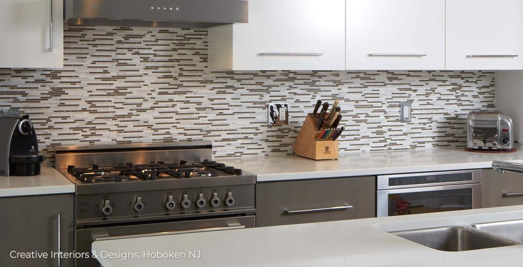 Mosaic pattern thin backsplash tiles in this modern kitchen.