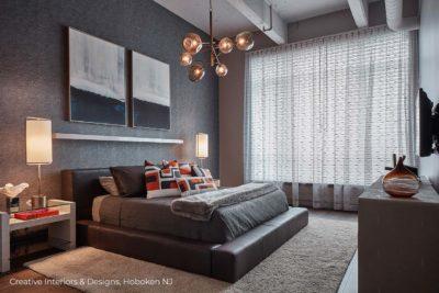 Geometric pattern pillows in this urban modern bedroom design.
