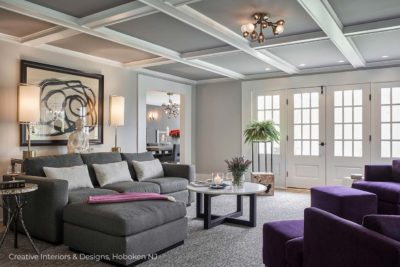 A modern grey family room with vaulted ceiling.